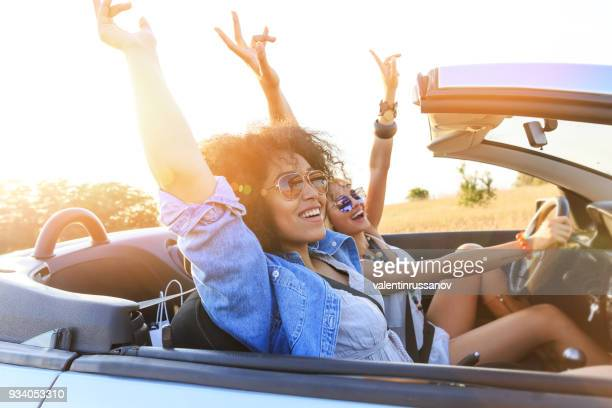 girlfriends having fun on road trip - road trip stock photos and pictures