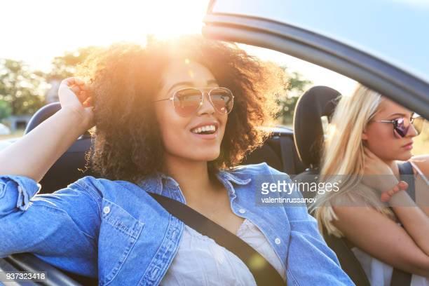 Girlfriends having fun on road trip