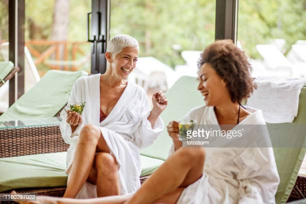 girlfriends having fun times at the wellness resort - girlfriend stock pictures, royalty-free photos & images