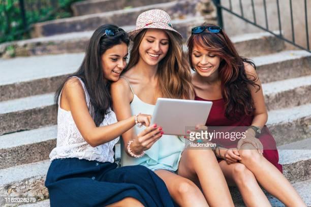 Girlfriends having fun with digital tablet