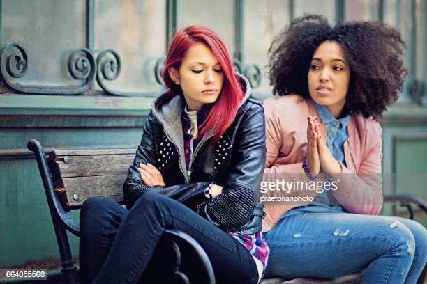 girlfriends in conflict are sulking each other - suplicar imagens e fotografias de stock
