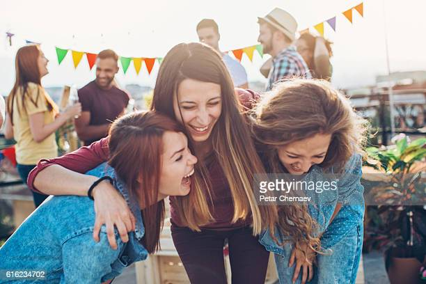 Girlfriends laughing out loud on a party