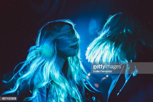 girlfriends on a night out - dancing stockfoto's en -beelden