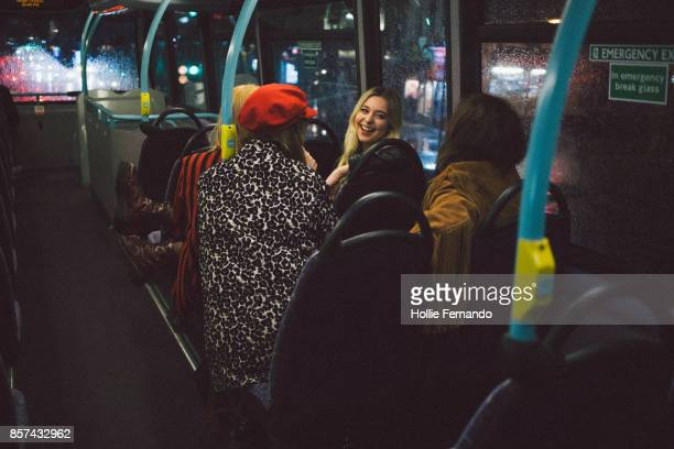 girlfriends on a night out - autocarro imagens e fotografias de stock
