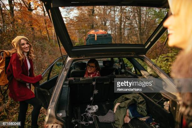 girlfriends on a road trip - open backpack stock pictures, royalty-free photos & images