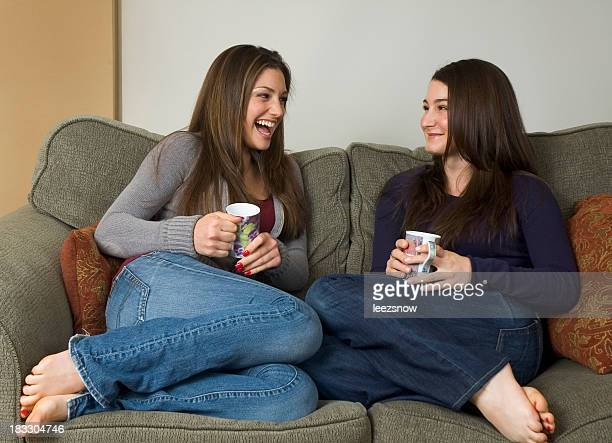 Girlfriends on Couch Chatting