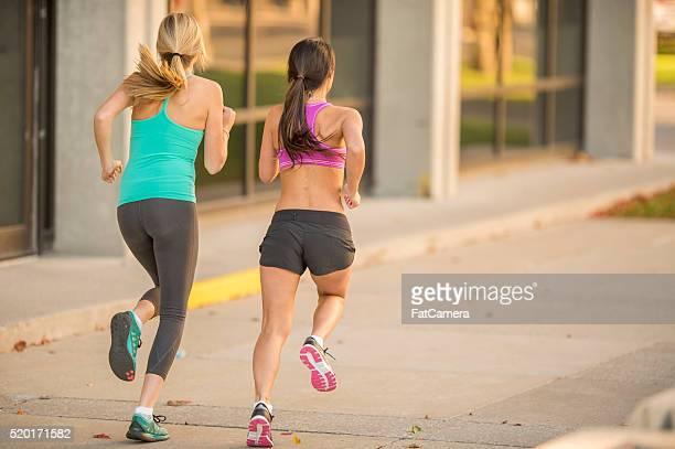 Girlfriends Running Together