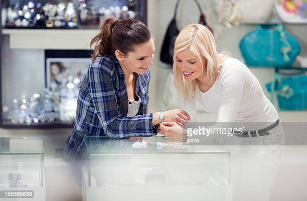 girlfriends shopping for jewelry - jewelry store stock pictures, royalty-free photos & images