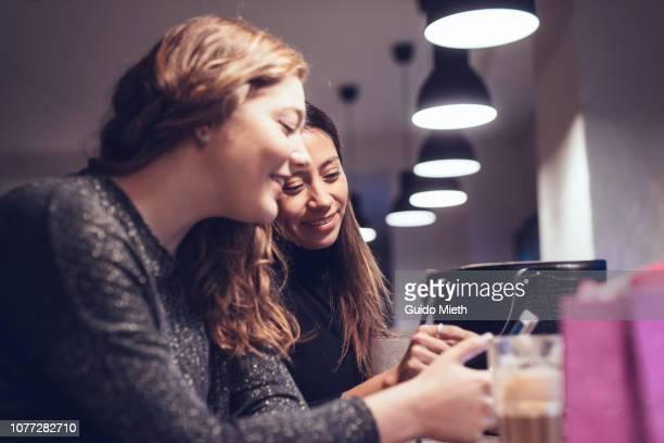Girlfriends talking while having a coffee break.
