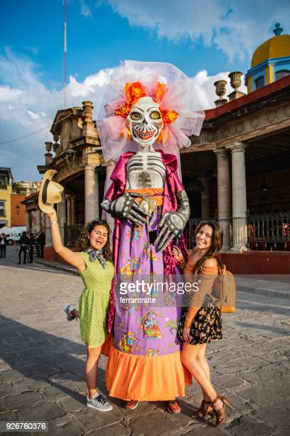 girlfriends traveling mexico - la catrina stock photos and pictures