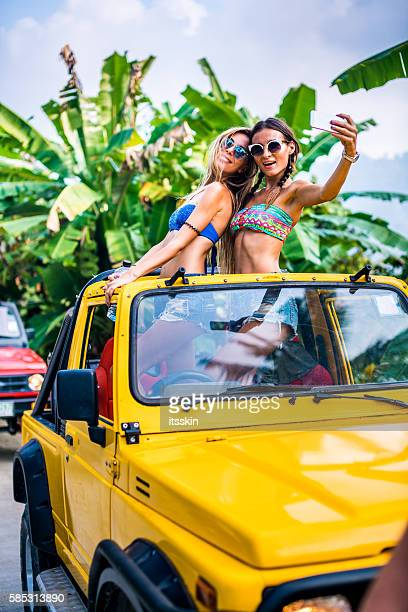 Girlfriends traveling with 4x4 car in the jungle