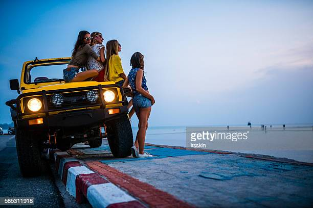 Girlfriends traveling with 4x4 car to the sea