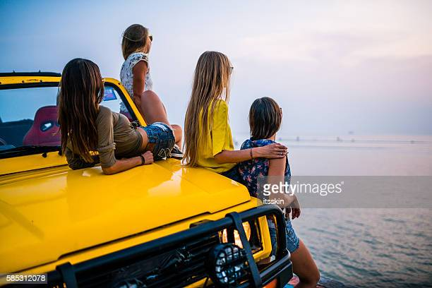 girlfriends traveling with 4x4 car to the sea - ko samui stock photos and pictures