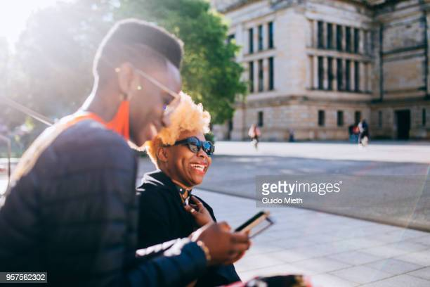Girlfriends using mobile phone.