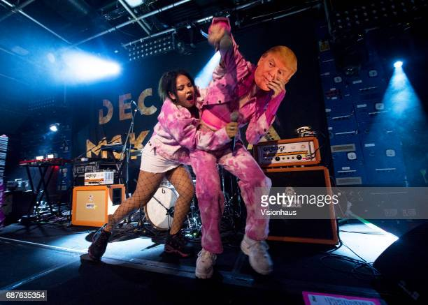Girli or Milly Toomey wears a Donald Trump mask whilst performing with DJ Kittty during her performance as support to Declan McKenna at Gorilla on...