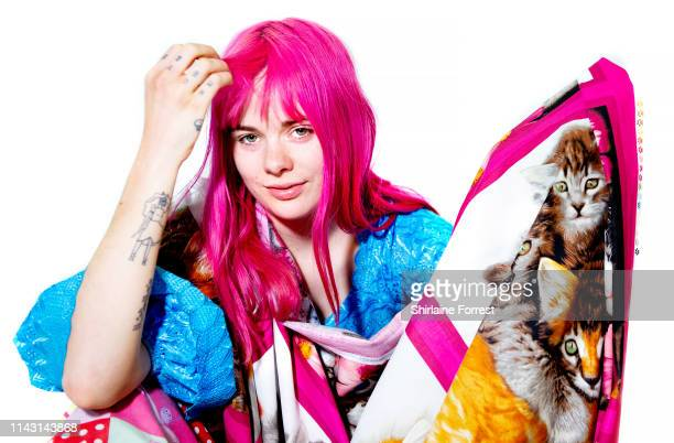 Girli poses backstage after meeting fans and signing copies of her debut album 'Odd One Out' during an instore event at HMV Manchester on April 16...