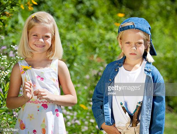 girlie girl vs. tomboy - tomboy stock photos and pictures