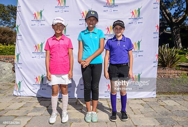 Girls 1011 age group 1st Place winner Leigh Chien 3rd place Eva Pett and 2nd place Kelly XU pose during their medal ceremony at The Drive Chip and...