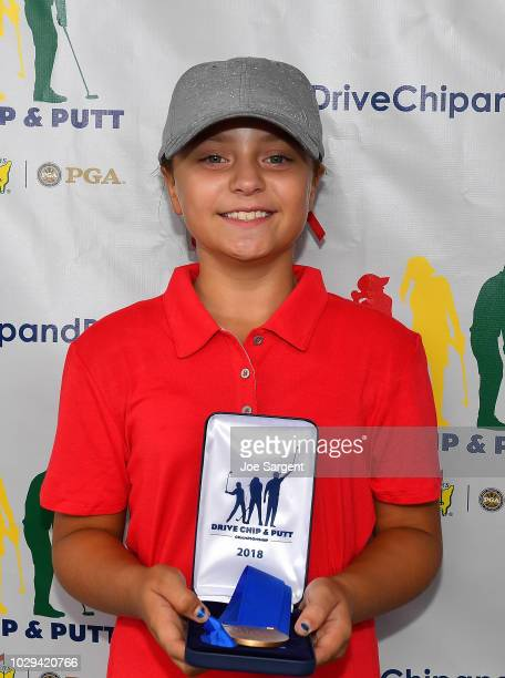 Girls 10-11 age group drive contest winner Mia Hammond poses with her medal during a regional round of Drive, Chip and Putt Championship at Muirfield...