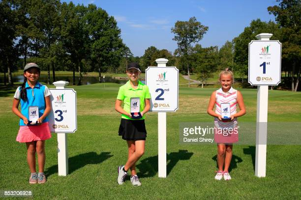 Girls 1011 Drive winner Gianna Clemente Trinity Beth and Allyson Duan pose during the Drive Chip and Putt Championship at The Honors Course on...