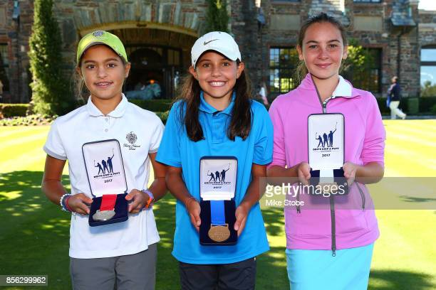 Girls 1011 overall winners Gabriella DeGasperis Vanessa Borovilos and Cc Kaplan pose during the Drive Chip and Putt Championship at Winged Foot Golf...