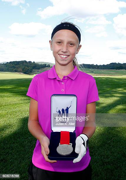 Girls 1011 putt contest winner Debra Brogan poses for photos during the regional round of Drive Chip and Putt Championship at Oakmont Country Club on...