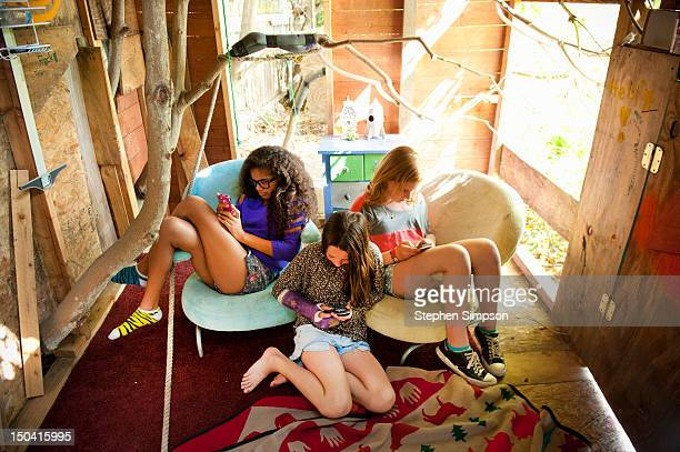 4 girls [11] on separate cell phones in clubhouse