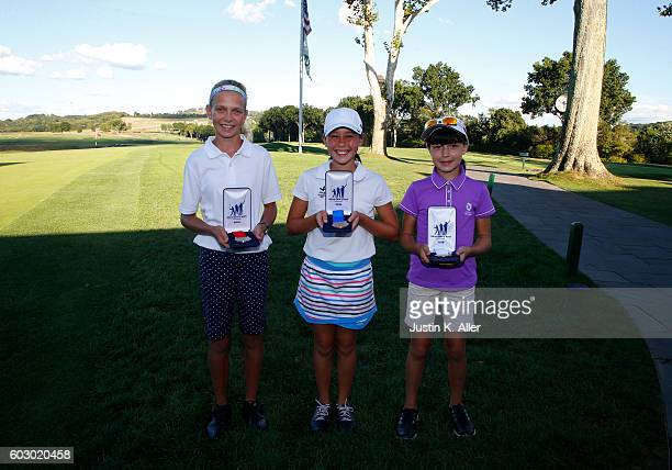 Girls 1213 overall contest top three second place Lydia Swan first place Julia Rabadam third place Anna Ritter pose for photos during the regional...