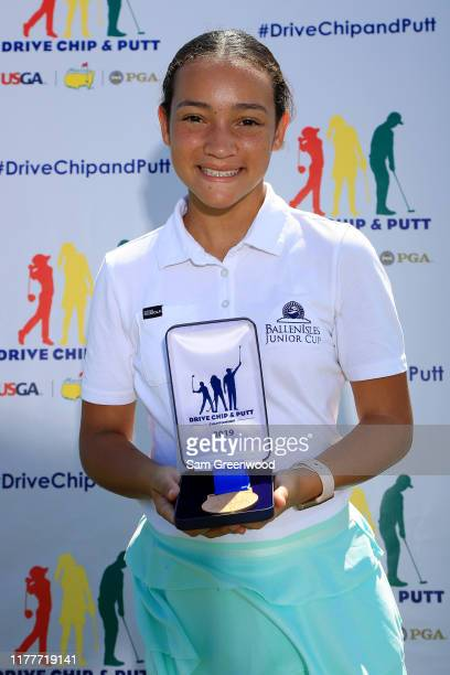 Girls 12-13 overall winner, Morgan Rodriguez, poses with her medal during a regional round of The Drive, Chip and Putt Championship at TPC Sawgrass...