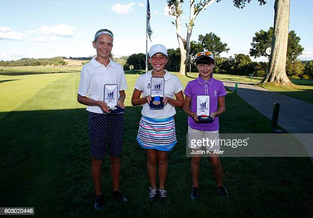 Girls 1213 putt contest top three third place Lydia Swan first place Julia Rabadam second place Anna Ritter pose for photos during the regional round...