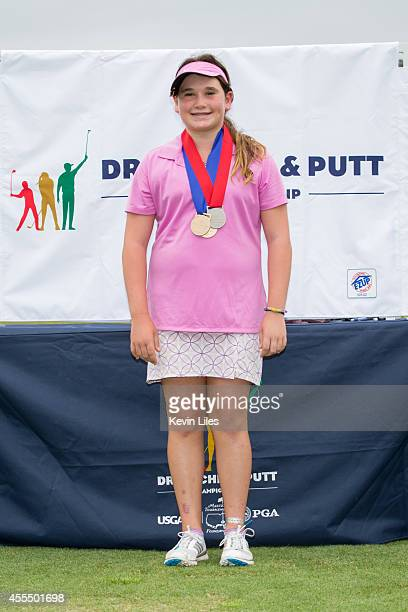 Girls 1213 putting winner Taylor Roberts poses with her medal at the regional round of the The Drive Chip and Putt Championship at TPC Sugarloaf on...