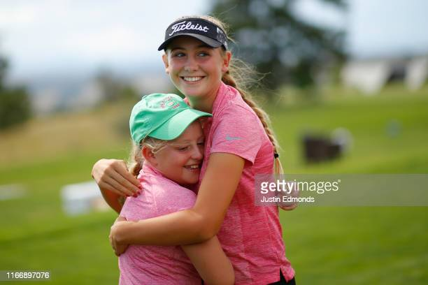 Girls 14-15 division winner Ali Mulhall gets a hug from her sister and 10-11 division competitor Milli Mulhall during the regional round of the...