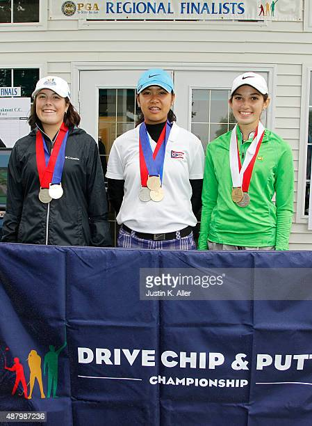 Girls 1415 driving contest top three second place Lauren Freyvogel first place Natalia Sompolvorachai third place Abby Zambruno pose for photos...