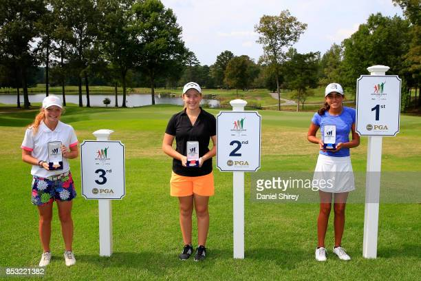 Girls 1415 Putt winners Kynadie Adams Hunter Grubbs and Carla Kay Hickam pose during the Drive Chip and Putt Championship at The Honors Course on...