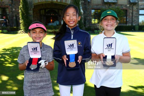 Girls 79 Overall Winners Catherine Anbino Lily Zang and Vincenza Papa pose during the Drive Chip and Putt Championship at Winged Foot Golf Club on...