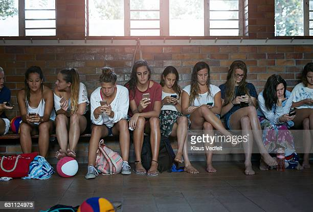 Girls all on their phones in changing room