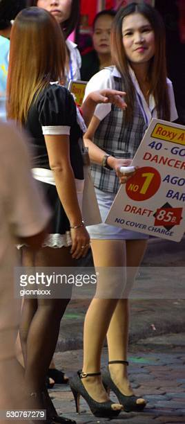 girls along walking street, pattaya - thailand - asian short skirt stock photos and pictures