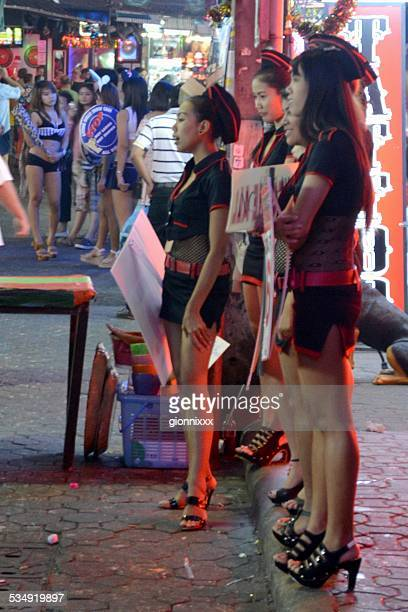 girls along walking street, pattaya - thailand - thailand prostitutes stock photos and pictures