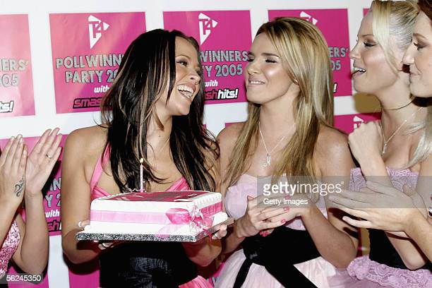 Girls Aloud Kimberley Walsh Nadine Coyle Sarah Harding and Nicola Roberts pose with a birthday cake for Kimberley in the press room at the T4 Poll...