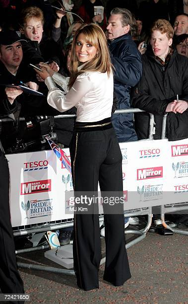 Girls Aloud member Cheryl Cole signs autographs at the Daily Mirror's Pride Of Britain Awards at ITV Centre on November 6 2006 in London England The...