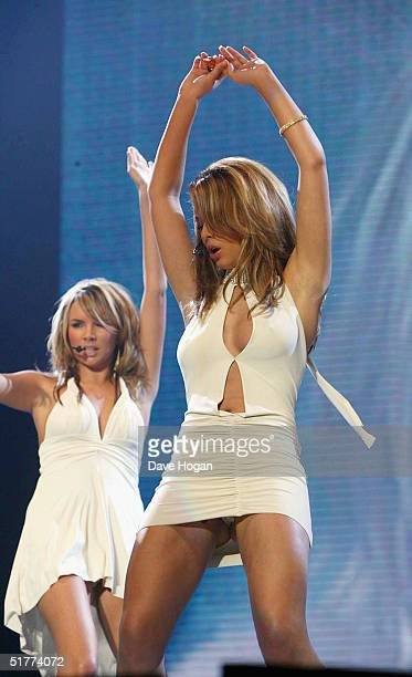 Girls Aloud member Cheryl Tweedy performs on stage at the Smash Hits T4 Poll Winners Party 2004 at Wembley Arena on November 21 2004 in London...
