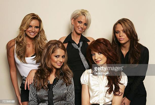 Girls Aloud members Nadine Coyle Sarah Harding Kimberley Walsh Nicola Roberts and Cheryl Tweedy pose for a portrait at BBC Television Centre on...