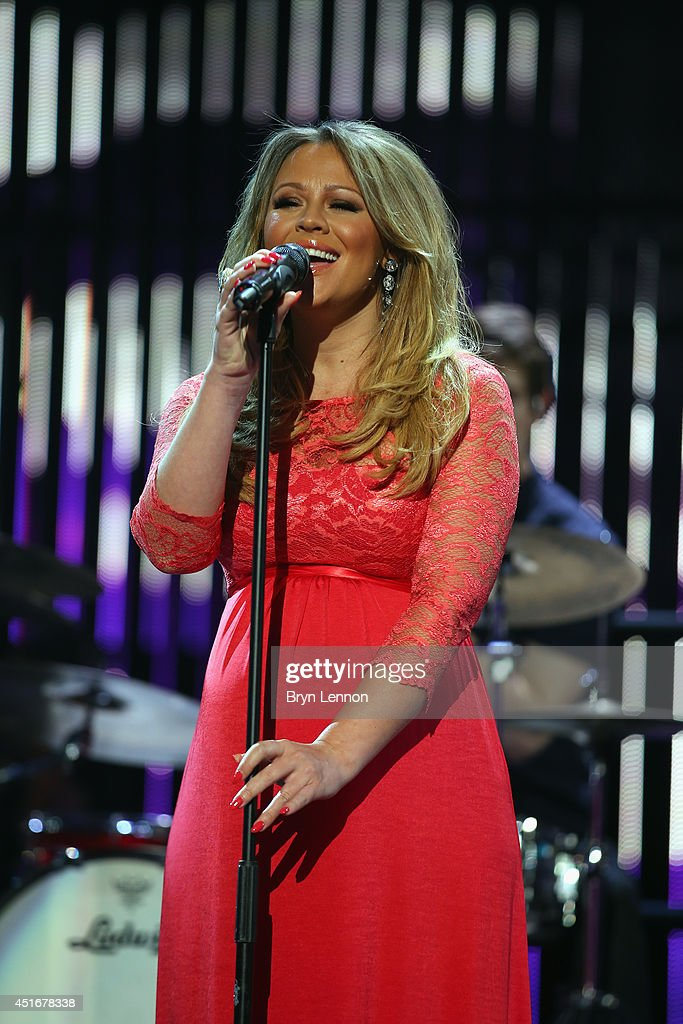 Girls Aloud star Kimberley Walsh sings during the 2014 Tour de France Team Presentation prior to the 2014 Le Tour de France Grand Depart on July 3, 2014 in Leeds, United Kingdom.