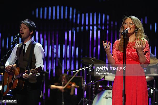 Girls Aloud star Kimberley Walsh sings with York singer/songwriter Alistair Griffin during the 2014 Tour de France Team Presentation prior to the...