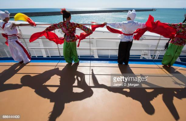 Girls and boys from the Luochuan Yangko dance troupe and Ansai waist drum troupe Yan'an city Shaanxi province China performing aboard Princess...