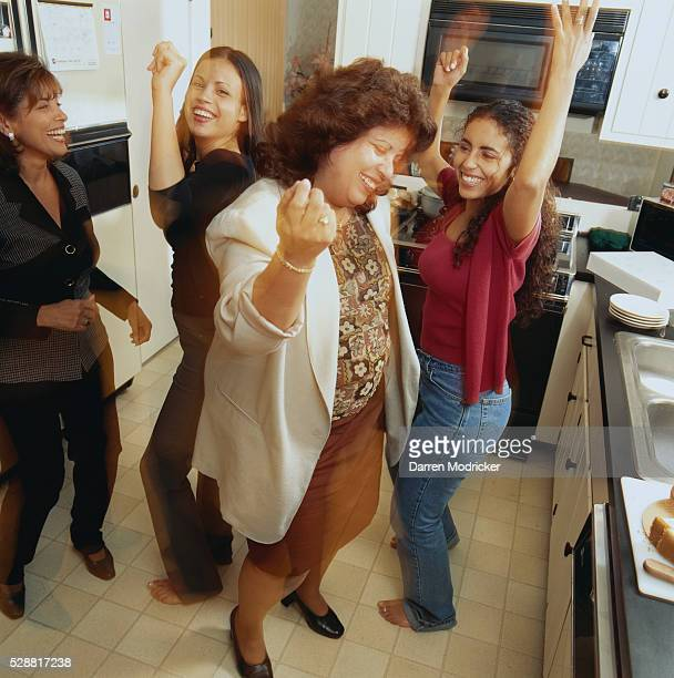 Girls and Mother Dancing in Kitchen