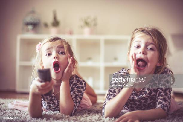 girls and remote. - play off stock pictures, royalty-free photos & images