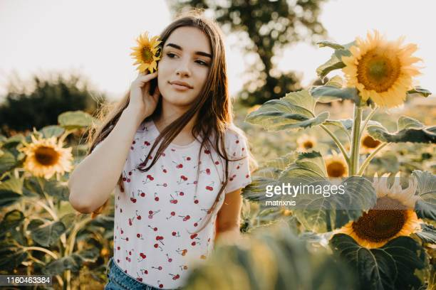 Girls and sunflowers in summer time.