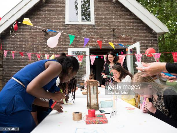 Girls and women decorating for birthday party
