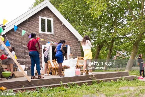 girls and women decorating for birthday party - party decoration stock pictures, royalty-free photos & images